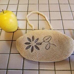 Vintage seed pearl wristlet style purse.